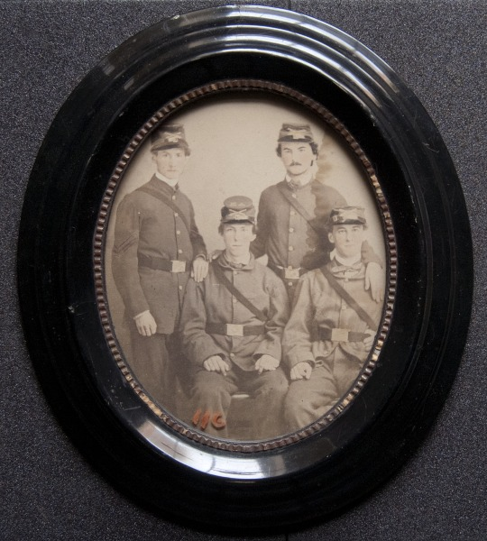 Image of four men (identities unknown) in uniform