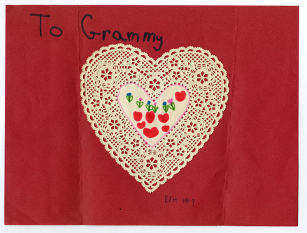 "Handmade Valentine addressed ""To Grammy"" made from a heart-shaped doily."