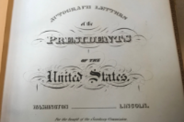 Title page of scrapbook containing letters signed by US presidents